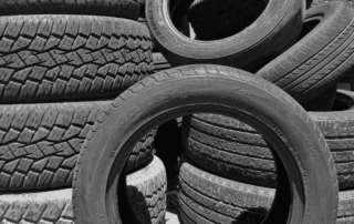 a pile of large tires by tire world exports